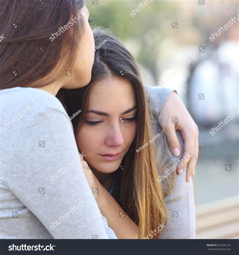 how to comfort a girlfriend sad girl crying friend comforting her stock photo