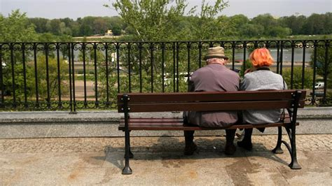 people sitting on bench achieving happiness despite everyday challenges live