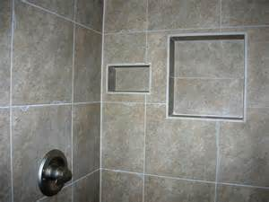 square gray ceramic tiled shower shelf combined with soap