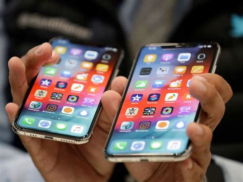 apple ceo tim cook defends pricing of new iphones abc news