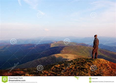 man standing on mountain top man standing on top of a mountain royalty free stock photo