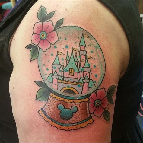 these bright snow globe tattoos these magical disney tattoos will make you believe in