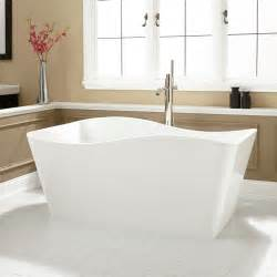 Fancy small space bathrooms designs with white freestanding ergonomics