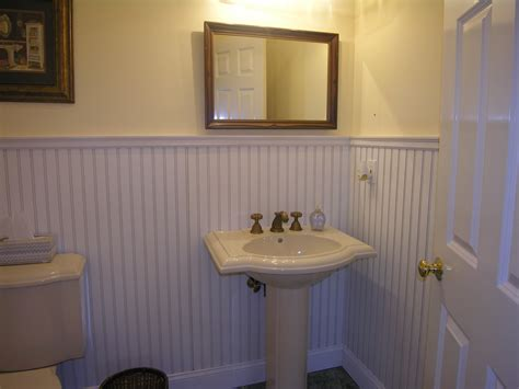 wainscoting bathroom walls covering a tile wall with a beadboard wainscot tim s
