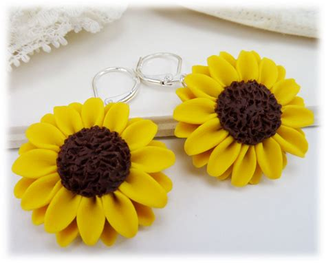 silver plated clip on sunflower earrings large yellow sunflower earrings stranded treasures