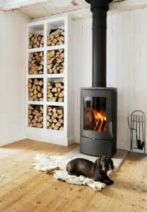 Small Fireplace Designs by 13 Wood Stove Decor Ideas For Your Home Brit Co