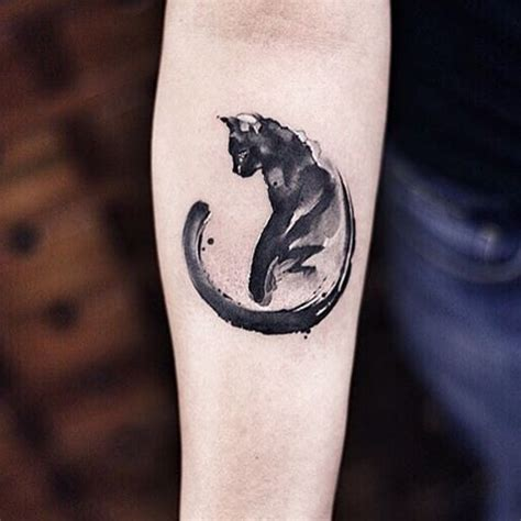 cat tattoo ink abstract style black ink detailed cat tattoo on forearm