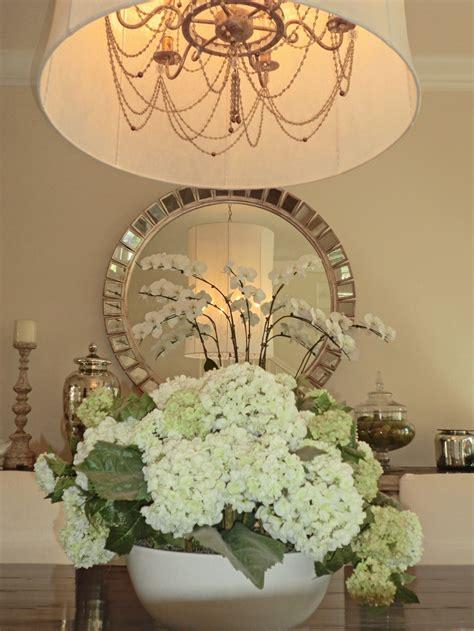 dining room centerpiece chandelier round mirror
