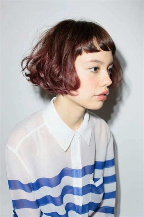 k mitchell short hairstyles with a soft bang wavy curly short bob with baby bangs curly wavy bobs