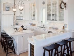 Classic coastal beach house kitchen with dark brown barstools and