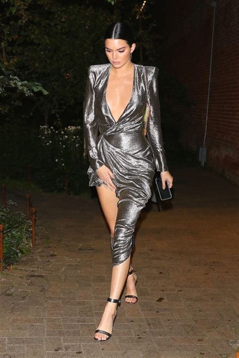 kendall jenner flashes lots  skin  sexy silver dress