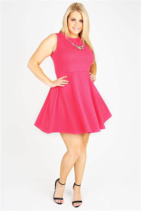 neon pink sleeveless skater dress with silver necklace