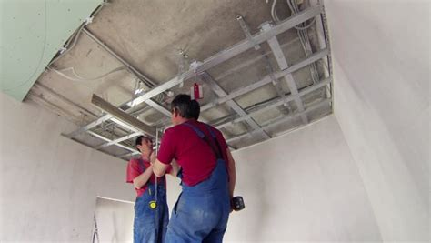 Laser Level For Ceiling by Two Workers Assemble Ceiling Mount For Suspended Ceiling