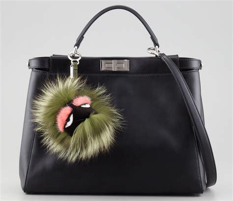 add a to your bag with a fendi fur charm purseblog