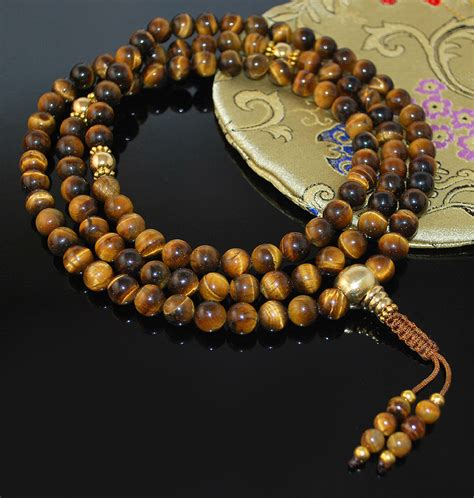 Mala Tiger Eye 8 Mm With Gold Vajra Ornament tigers eye gold mala