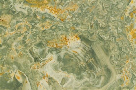 yellow wavy pattern wavy green and yellow granite royalty free stock photo
