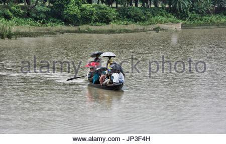 rowboat in the rain rowing in the rain stock photo 14659613 alamy