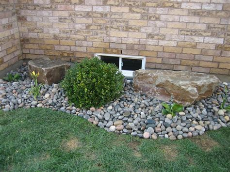 river rock flower bed low maintenance landscaping ideas project description