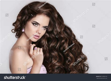 beautiful model with elegant hairstyle stock photo long curly hair beautiful brunette girl stock photo