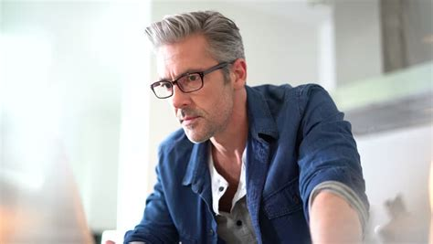 45 years old man pics handsome 45 year old man at home connected on laptop stock