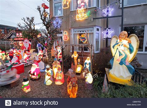 kitsch christmas decorations in suburban house garden