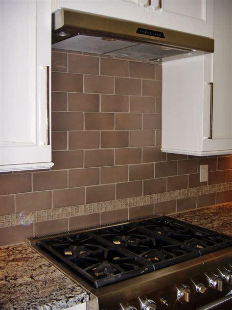 porcelain tile kitchen backsplash 4x8 porcelain tile with glass crackle accent at kitchen backsplash tile we ve done
