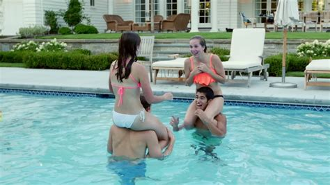 naked backyard pool teen friends have a fun chicken fight at a pool party