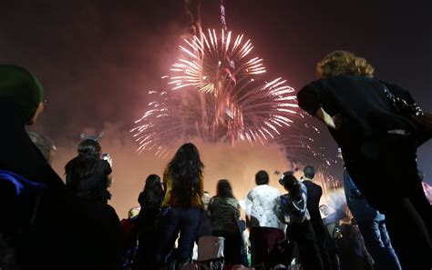 how to celebrate new years day look at a firework display during a new year