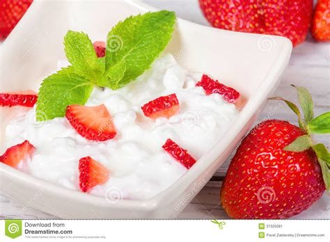 cottage cheese with strawberry and mint stock image