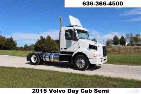 2015 volvo semi truck volvo vnm64t200 2015 daycab semi trucks