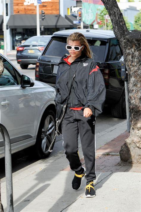 sofia richie wears reebok jacket adidas track pants