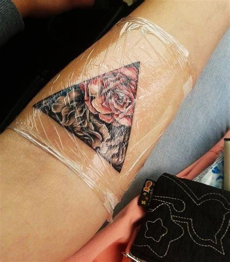 inked nation tattoo e piercing floral triangle tattoo ink piercings pinterest