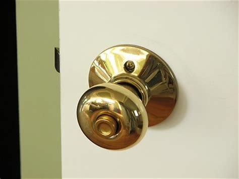 outdated gold door knob welcome to the home of the
