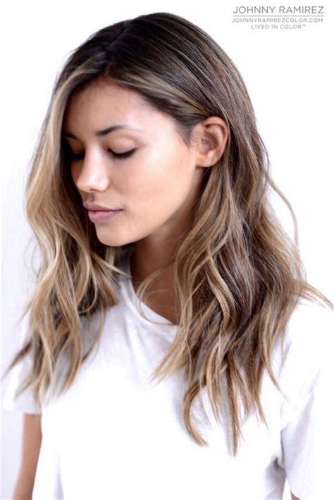 medium length brown hair with bangs and blonde highlights medium length brown hair