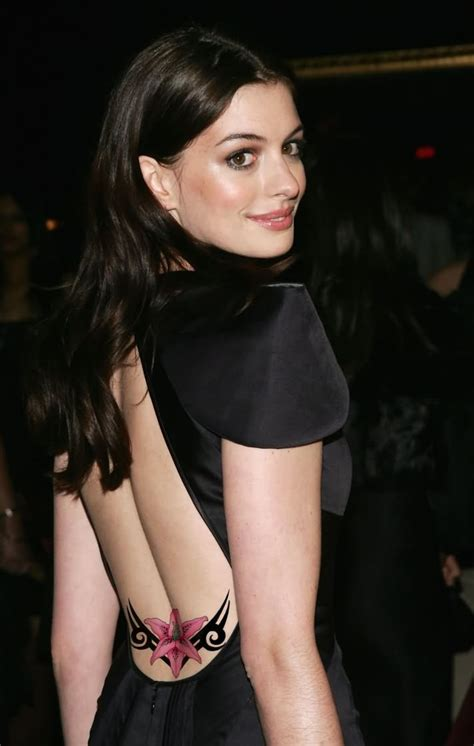 pink ink flower tattoo on celebrity anne hathaway lower back