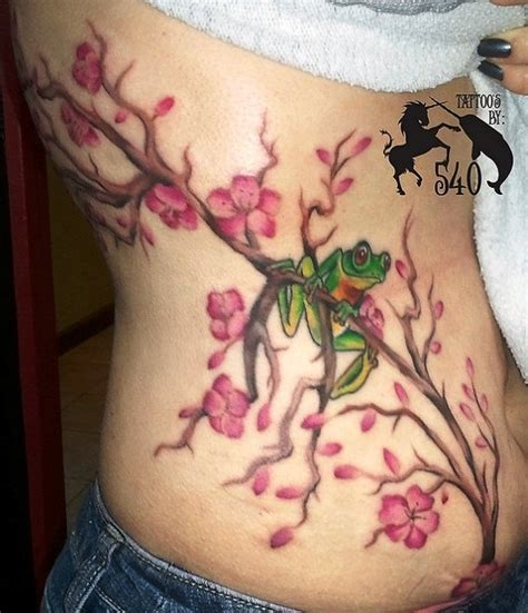 cherry blossom tattoo on side cherry blossom bamboo tree on rib side