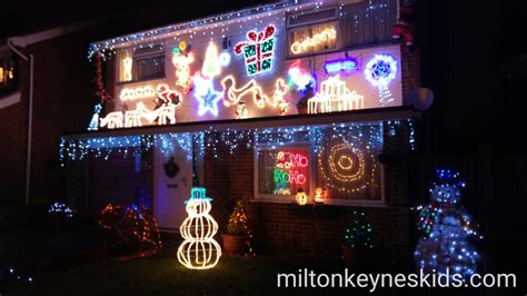three houses with christmas lights on melrose avenue