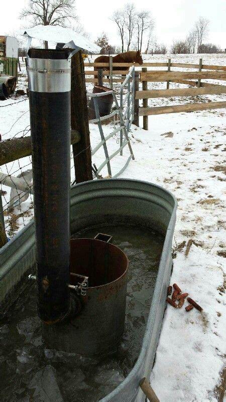 wood fired stock tank heater  horses stock tank