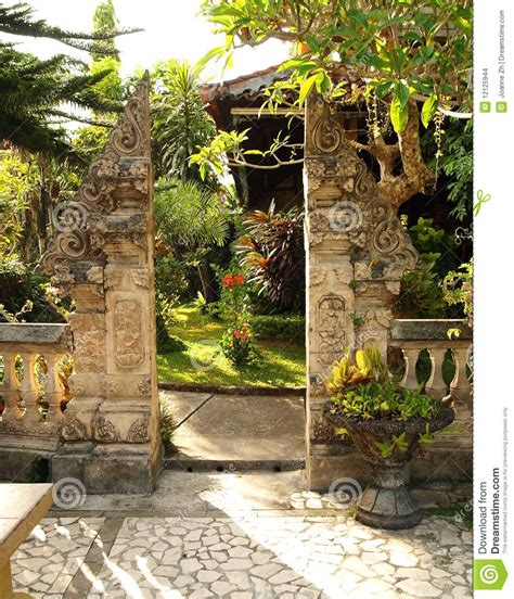 Stone Cottage House Plans traditional split gate in balinese garden stock photo
