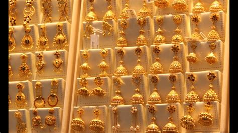 design photo collections latest joyalukkas jewellery gold earrings collections