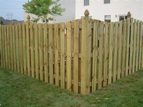 Painting Aluminum Screen Enclosures by Wooden Fence
