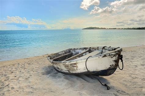 old boat on beach old row boat on the beach small boats pinterest look