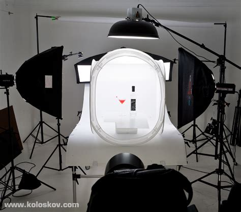 product photography lighting setup shooting glassware on white background high key in
