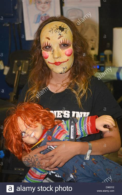 nyc tattoo music festival girl in a mask with a chucky doll at the new york tattoo