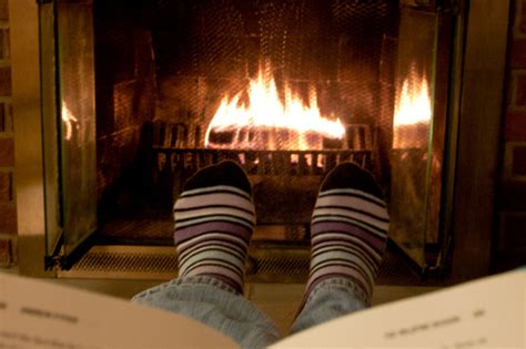Fireplace Book by Reading Book By Fireplace Stock Photo Getty Images