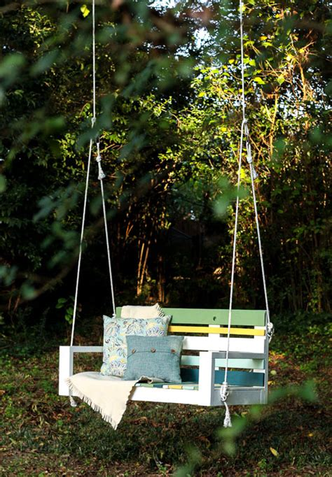swing hanging from tree building a striped porch swing using pallet wood pretty