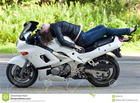 white motorbike woman lies on a motorcycle royalty free stock photos