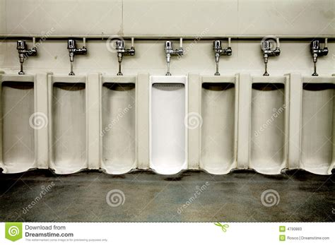 tumblr mens bathroom dirty men s bathroom with one clean urinal stock image