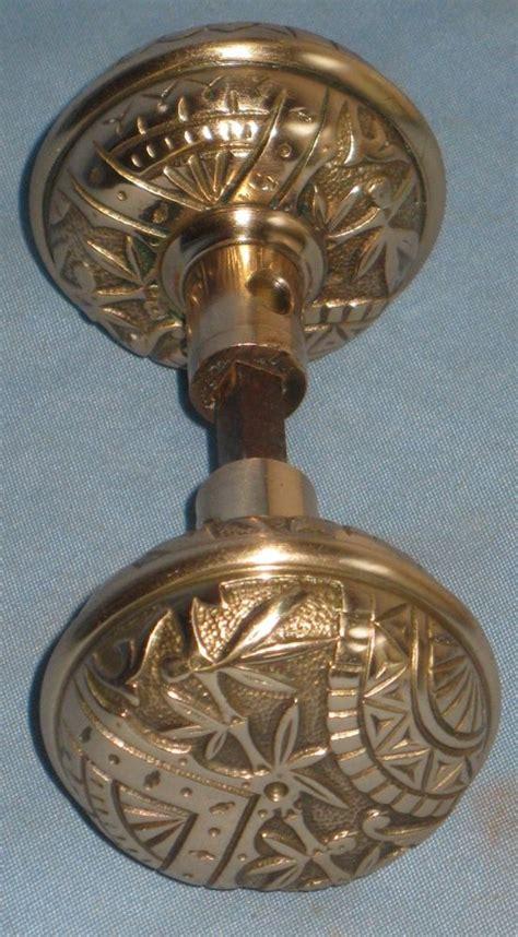 antique pair of unmarked solid brass bronze door knobs