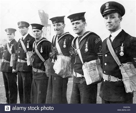 Two Officers by Royal Navy World War Two Petty Officers And Following